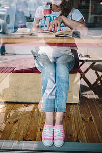 Woman reading book at coffee shop