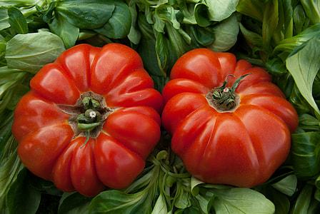 closeup photo of two ripe tomatoes