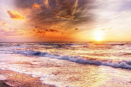 wave explotion during golden hours