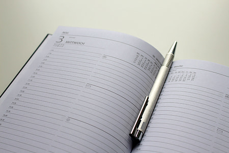 retractable pen inside business diary book