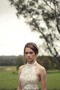 woman in white lace halter top during daytime