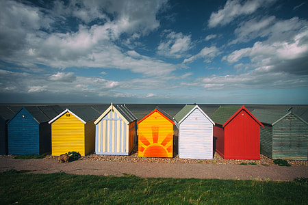 Wide-angle capture of some coastal beach huts on a summer day, image captured in Kent, England
