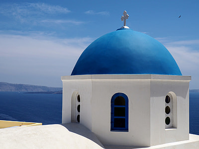 white and blue dome concrete church building near ocean during daytime