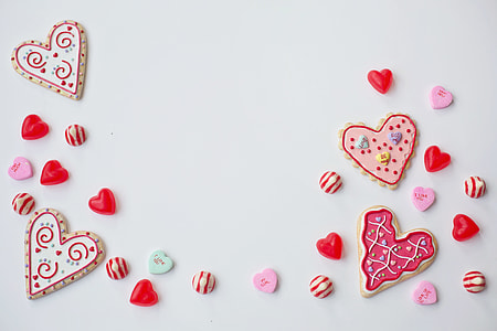 Overhead shot of love hearts and Valentine's Day treats