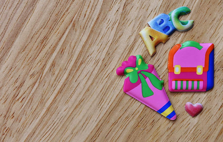 assorted-color toys on brown wooden surface