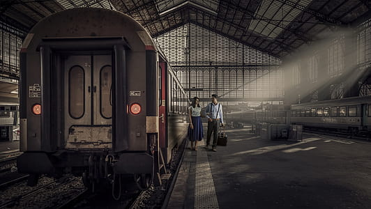 woman and man beside train photo