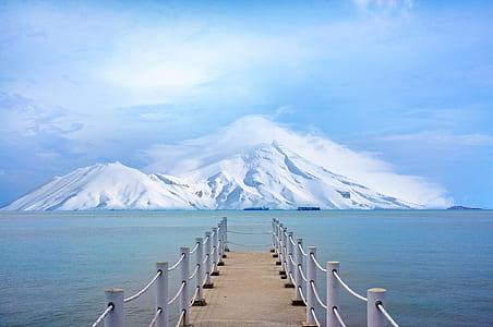 white mountain with bridge photo