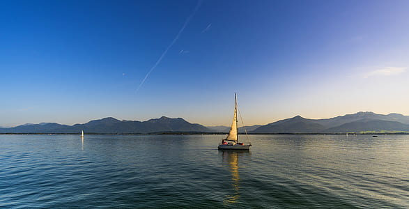 landscape photography sailboat on ocean during daytime