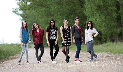 six girls taking a group pictures