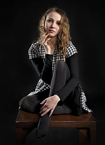 woman in white and black checkered button-up shirt