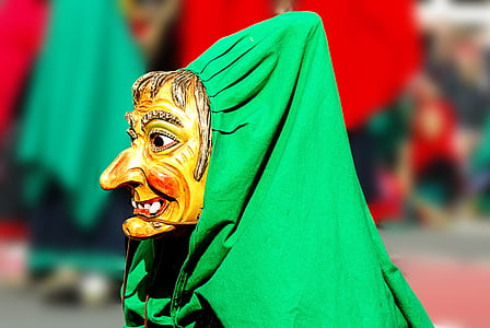 person wearing mask covered with green textile