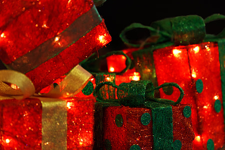 five red and green lightened gift boxes