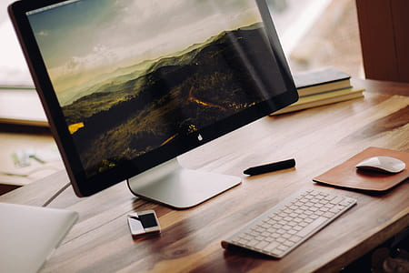 black imac; Apple magic keyboard; Apple magic mouse on table