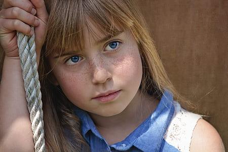 girl holding rope