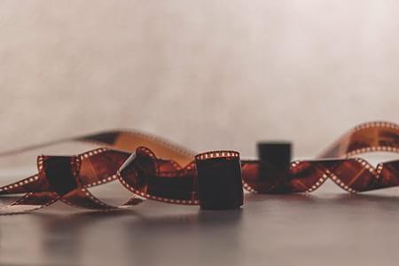 closeup photo of camera film on white surface