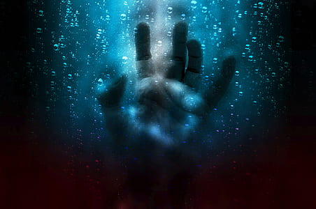 left human hand touching blue screen