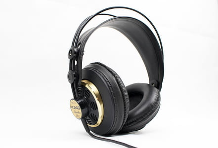 black and gold corded headphones