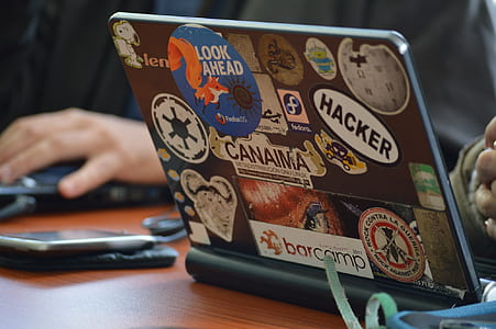 assorted stickers on black laptop computer