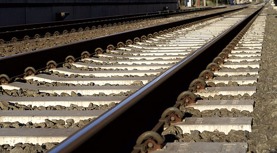 Black and Gray Metal Train Rail