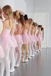 photo of girl's wearing pink ballet dress