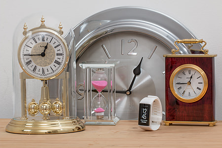 assorted-color and type of clocks