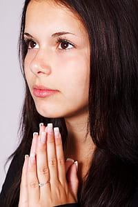 girl in black blouse praying hand
