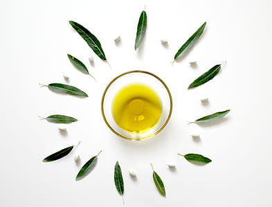 olive oil in clear glass cup