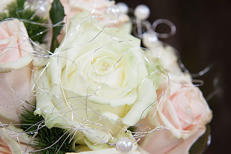 close-up photo of white and pink faux rose arrangement