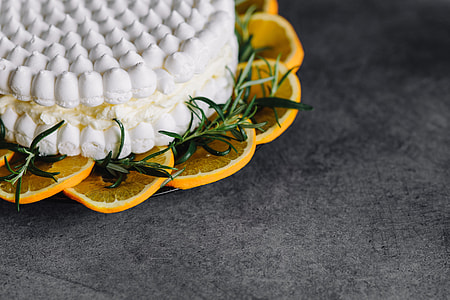 Meringue Cake with whipped cream and oranges