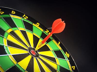 dart on red dartboard
