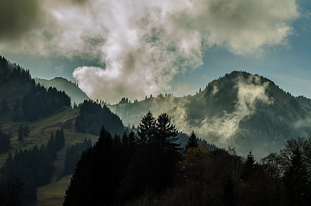 skyline photography of mountain under clouds during daytime
