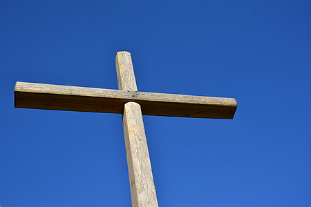 brown wooden cross under clear blue sky during daytime