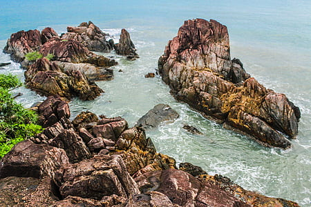 Brown Rock Formations Beside Ocean