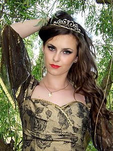 woman wearing brown and black floral dress wearing silver-colored tiara