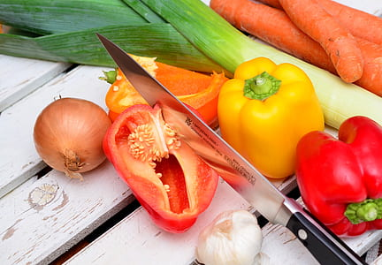 black and gray steel knife and assorted vegetables