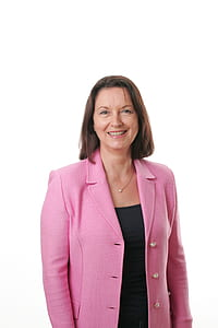 Smiling Woman Wearing Black Shirt and Pink Button Up Blazer