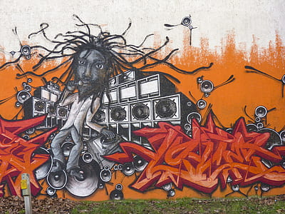 close-up photo of man near speaker graffiti