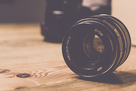 Camera Lens Wooden Table