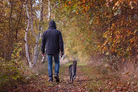 man beside black dog