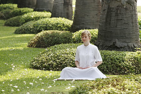 woman in white dress on green grass