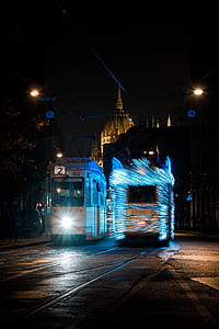 white and blue bus at night