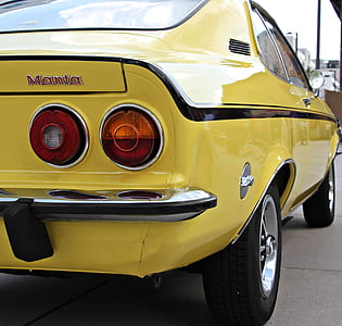 Yellow and Black Muscle Car Parked during Daytime