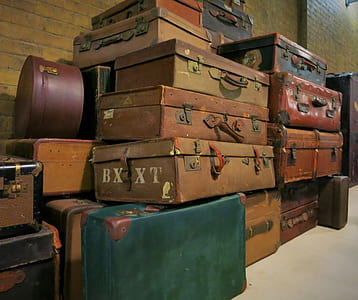 assorted-color suitcases
