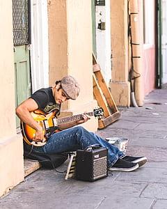 man holding jazz guitar