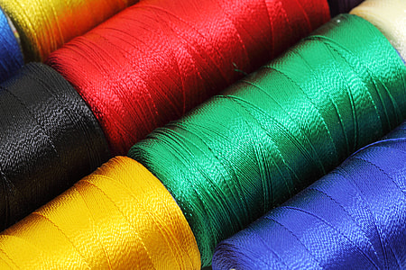 close-up photography of assorted-color threads