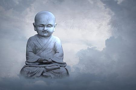 Gautama Buddha statue under clouds