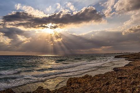 wavy sea under sun