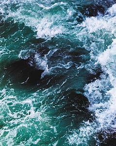 emerald green water splash photo