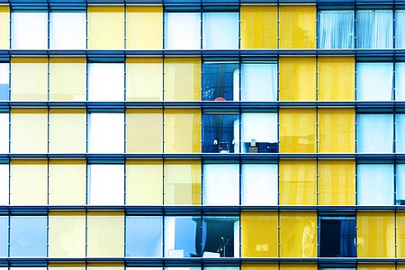 Colourful buildings with grid-based design and windows