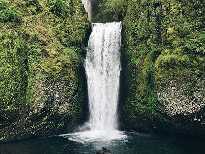 waterfalls between rocks with gras